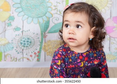 Portrait of 1 and a half gorgeous baby girl indoor.
