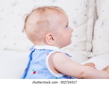 Portrait of 1 year old baby girl playing at home.