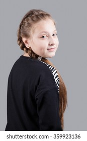 Portrait of a 10 year old girl, studio shot.