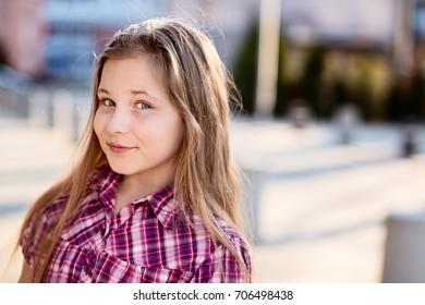 Portrait of 10 years happy schoolgirl. Back to school