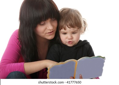 Portrait of a 2 year old girl with her mum  reading book isolated on white background