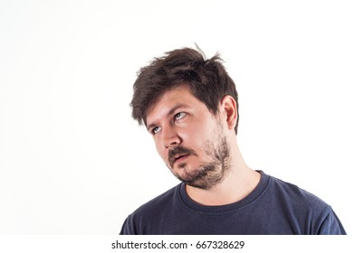 Portrait of 30 years old man with boring and misunderstanding face and Disheveled hair style