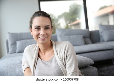 Portrait of 30-year-old woman relaxing at home