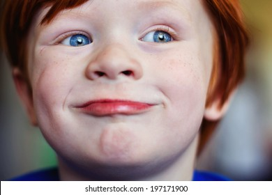 Portrait of a 4 year old redheaded boy -- image taken indoors using natural light