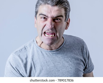 portrait of 40s to 50s white angry and upset guy and crazy furious and aggressive face expression nagging and complaining isolated on grey background in emotions and feelings concept