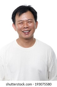 Portrait of 40s Asian middle aged male smiling, isolated on white background.