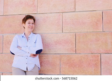 Portrait of 45 years old woman outdoors