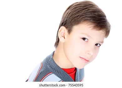 Portrait of a 9 year boy. Isolated over white background.