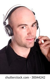A portrait about a bald customer service operator young man whit  headphone