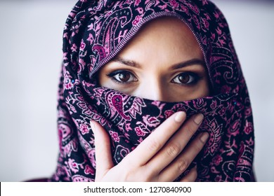 Portrait of abused beautiful arabic middle eastern woman wearing hijab