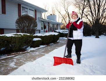 Portrait of Active Senior Citizen with Snow Shovel (Wide Perspective Showing More of Sidewalk)