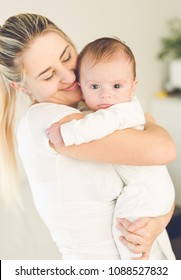 Portrait of adorable 3 months old baby with smiling mother