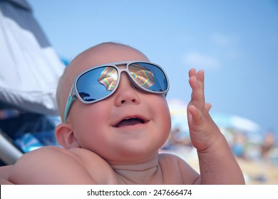 Portrait of adorable baby boy with sunglasses