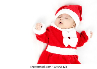 Portrait of adorable baby girl with santa costume. Isolated on white background with copy space
