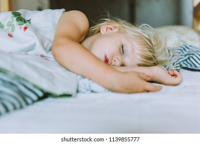 Portrait of adorable baby girl sleeping in bed