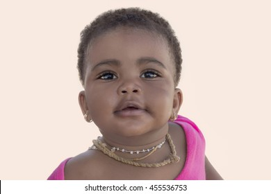 Portrait of an adorable baby girl smiling, nine months old