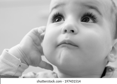 Portrait of adorable baby looking up