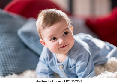 Portrait of an adorable baby on the couch in the living room