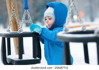 Portrait of adorable baby on playground