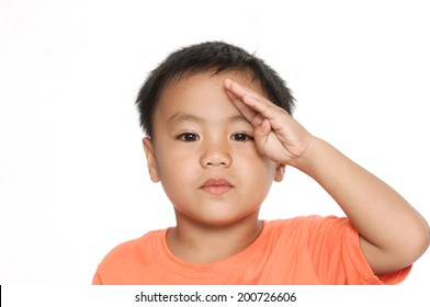 Portrait of adorable boy doing a military