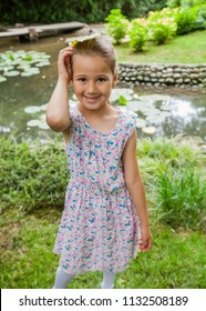 Portrait of adorable child in nature, beautiful spring day at park