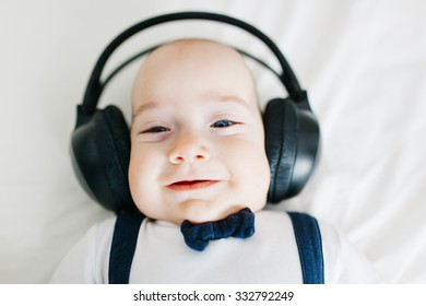 Portrait of an adorable dj baby boy with headphones