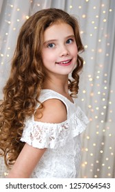 Portrait of adorable happy smiling little girl child in princess dress in christmas time