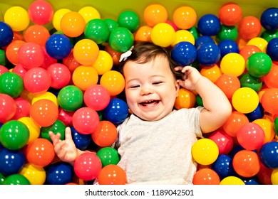 Portrait of a adorable infant on colorful balls
