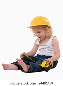 Portrait of an adorable little blond curly hair three year old boy wearing white muscle top and jeans and yellow hard hat dressed like a construction worker holding on to a measuring tape