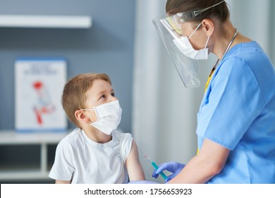 Portrait of adorable little boy being vaccinate at doctor's office