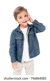 portrait of adorable little boy talking on smartphone isolated on white