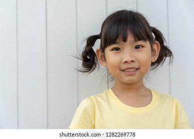 Portrait adorable little girl Asian happy smile