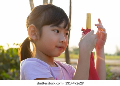 Portrait adorable little girl Asian happy smile Rim Light