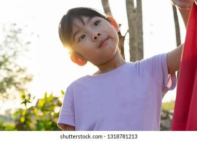 Portrait adorable little girl Asian happy Rim Light