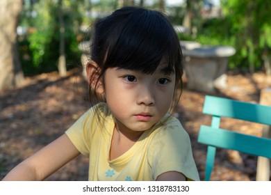 Portrait adorable little girl Asian sad