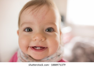 Portrait of adorable little girl. Cute smile face. Baby teething. First teeth.