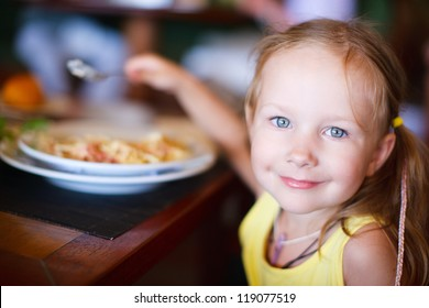 Portrait of adorable little girl having lunch