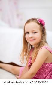 Portrait of adorable little girl in her room