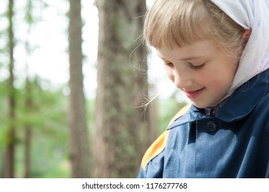 Portrait of an adorable little girl outdoors
