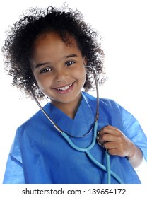 """Portrait of an adorable preschool """"doctor"""" in scrubs happily listening to her own heart through a stethoscope.  On a white background."""