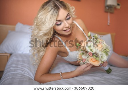 08bf4c0ef6b portrait of adorable sexy young bride is laying in white lingerie on the  bed with wedding