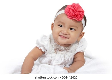 Portrait of adorable smiling baby crawl in bed, isolated on white background