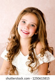 Portrait of adorable smiling little girl child isolated