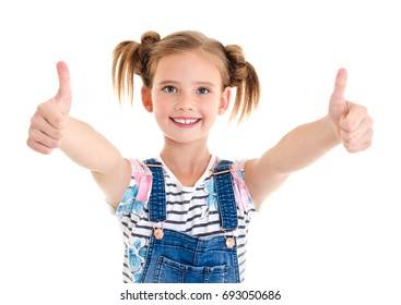 Portrait of adorable smiling little girl child with two thumbs up isolated on a white