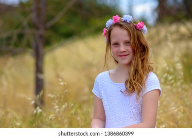 Portrait adorable teenage girl on wheat field. Shavuot. Summer or Autumn. Harvest.