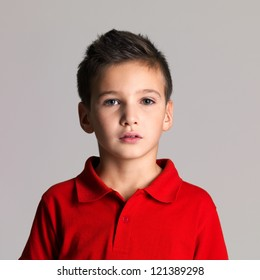 Portrait of adorable young beautiful boy posing at studio