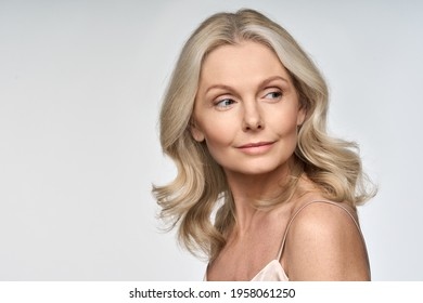 Portrait of adult 50 years old model woman isolated on white background advertising skin care spa treatment. Mid age tightening rejuvenating face and body care cosmetics concept.