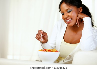 Portrait of an adult afro-american woman having healthy breakfast at home indoor. with copyspace