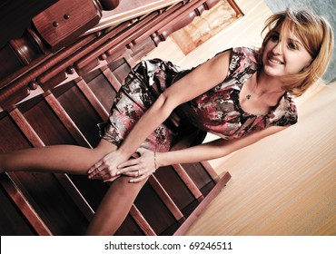 Portrait of adult attractive woman indoor waiting on stairs at home for her valentine