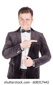 Portrait adult businessman  looking and pointing finger  gesture . happiness, gesture, emotions and people concept. Image on white  studio background.